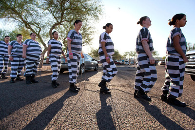 guardian:  Members of America's only all-female chain gang march to a bus that will transport them to their worksite outside Estrella jail in Phoenix, Az. With a few exceptions, chain gangs were abandoned in the U.S. by 1955, but Arizona reintroduced the practice in 1995. The women volunteer for the duty, looking to break the monotony of jail life. Most are in for minor convictions and are housed at a collection of surplus military tents erected next to the Maricopa County jail to ease overcrowding. Photograph: Jim Lo Scalzo/EPA  So Let's summarize, racism against legal immigrants, misogynist law against women birth control and now this. What else?