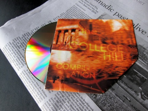 "Back in the summer of 2000, we designed cover graphics and a CD sleeve for the album ""The College Hill Compilation"" by our good friend Vee Yuttanant Boonyongmareerat. Longer than his last name was his credit in the album; he composed, produced, arranged, and performed nearly all of the songs in the album! For the front cover, we took photos of the College Hill (Brown University) and turned them into a monochromic dreamscape in which the details of the surroundings were blurry, yet the memories of people were forever clear. On the back cover, credits and song details were thrown together in a way that was intentionally disorderly. The compilation album, with songs written in different decades and performed by people in different corners of the world, was put together that way, too. Perhaps the coolest part of this work was how the whole CD sleeve can be made out of just one piece of paper with the graphics printed on one side. We designed the master layout such that it can be printed out, cut, folded, glued, and — VOILÀ! — turned into a protective sleeve for the CD. Cool, right? Why, thank you!"