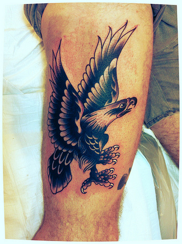 drawn on, and tattooed today. super fun black with a bit of grey eagle on thigh!