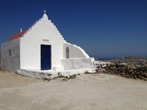 (Mykonos) There are hundreds of small chapels dotting the Mykonos landscape.  We found this one just off a goat-path (with, yes, goats on it) up in the mountains near a 2000 year-old Roman ruin of an old citadel.