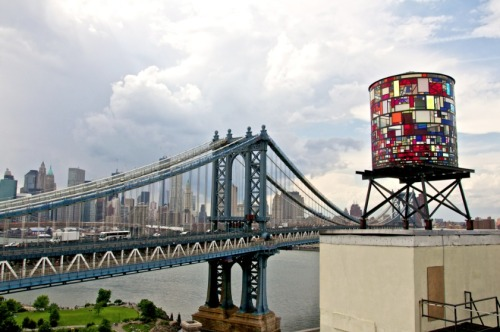 Location: DUMBO, Brooklyn USASituated on the rooftop of 20 Jay Street the sculpture is viewable from the parks and streets of Dumbo, the Brooklyn and Manhattan Bridges, FDR Drive and Lower Manhattan. The prime viewing locations are the Brooklyn Bridge Park at Washington Street(see map), and the Manhattan Bridge bike path.Information:Tom Fruin Studio is pleased to present Watertower, a new sculptural artwork by Brooklyn artist Tom Fruin. For the US premiere of his internationally recognized Icon series, Fruin has created a monumental water tower sculpture in colorful salvaged plexiglas and steel. Watertower is mounted high upon a water tower platform becoming part of the DUMBO, Brooklyn skyline. This project is the fourth work in the plexiglas and steel patchwork Icon series which features scavenged, reclaimed, and recycled materials constructed into sculptural tributes to architectural icons around the world, from the obelisco of Buenos Aires, to the kolonihavehuse of Copenhagen. The series can be seen as a three-dimensional evolution of Fruin's found drug-bag quilts and flags for which he is well known.Fruin, who often works with reclaimed and discarded materials, has composed Watertower from roughly one thousand scraps of plexiglas. It includes such details as interior and exterior access ladders and an operable roof hatch. The locally-sourced plexi came from all over New York City—from the floors of Chinatown sign shops, to the closed DUMBO studio of artist Dennis Oppenheim, to Astoria's demolition salvage warehouse Build It Green!NYC.Illuminated by the sun during the day and by Ardunio-controlled light sequences designed by Ryan Holsopple at night, this beacon of light is a tribute to the iconic New York water tower and a symbol of the vibrancy of Brooklyn. Watertower opened June 7th, with daily light shows beginning at dusk and continuing to morning. Tom Fruin (b. 1974) works in Brooklyn, NY. His work is a part of many international museums and collections, most notably The Hanck Collection at the Museum Kunstpalast in Düsseldorf, Germany; the Richard J. Massey Foundation for Arts and Sciences in New York, NY; and the Buenos Aires Design Center (Centro Metropolitano de Diseño) in Buenos Aires, Argentina. Fruin's most recent contribution to public art in New York City is the 50 foot tall neon sculpture HOTEL on the Wythe Hotel in Williamsburg, Brooklyn.This public sculpture is supported in part through a Brooklyn Arts Council Community Arts Grant, a Build It Green materials grant, and The Richard J. Massey Foundation for Arts and Sciences. Additional technical support provided by Nick Liberis at Platform4 Collaborative Design; J. D. Messick; and Two Trees Management Co.Watertower, 2012found plexiglas, steel, bolts20 x 10 x 10 feetFor additional press information please contact Becky@tomfruin.com. Photos by Robert Banat. *reblogged from tomfruin.com