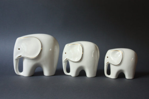 (via MidCentury Modern Set of 3 Porcelain Elephants by GoGoBerlinette)