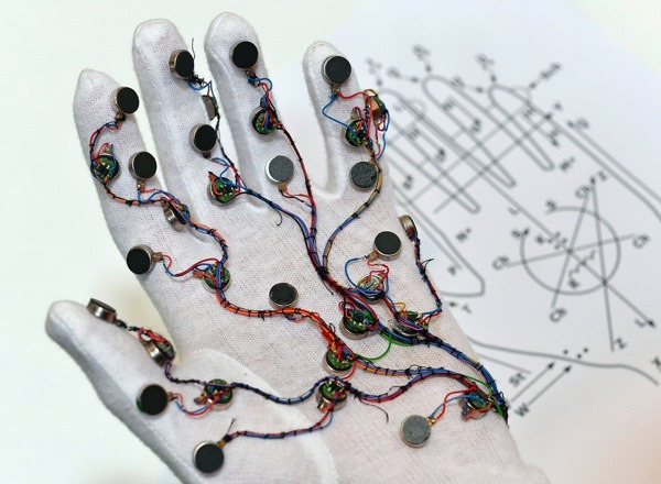 Glove Translates Tactile Sign Language to Help Persons Who Are Deaf and Blind Communicate Engineers at Germany's Design Research Lab created the Mobile Lorm Glove to help people who are both deaf and blind communicate with other people via mobile technology. The nodes on the glove are pressure sensors used to translate Lorm, a tactile sign language, into text or speech. The glove also does reverse translation, with vibrating motors that deliver feedback patterns according to Lorm's method of assigning letters to different parts of the palm.   (via joshbyard, iCandy: Connecting the Dots - IEEE Spectrum)