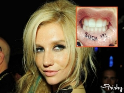 "Ke$ha Tattoos The Word ""Suck It"" On Her Lip - The Frisky"