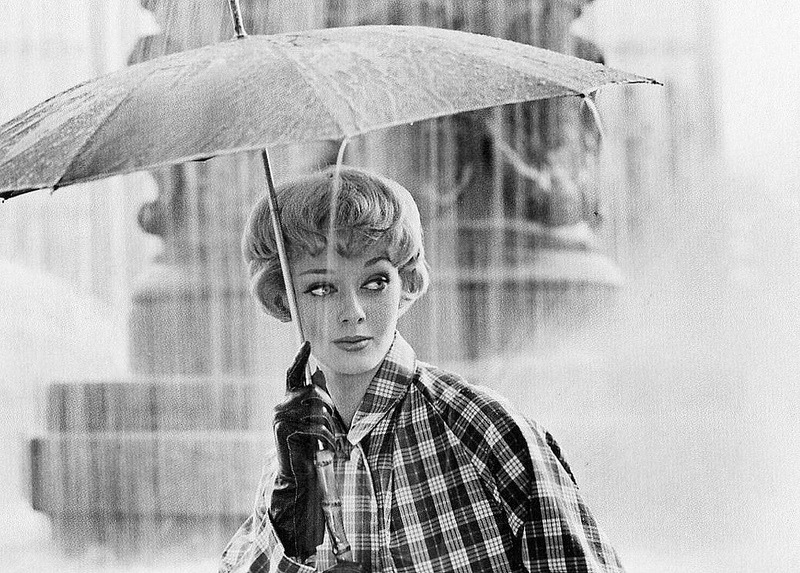 Ina Balke in raincoat with an umbrella, photo by Regina Relang, 1955
