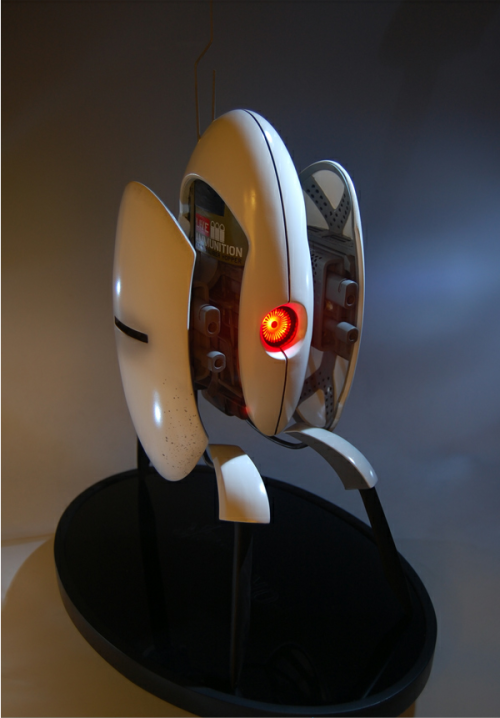 "videogamenostalgia:  ""Defend Your Home With Your Very Own Portal 2 Turret"" Valve and the merchandise vendor, Gaming Heads, has teamed up together to bring you the latest in nerdy décor. The Aperture turret stands at approximately 16 inches tall and includes a motion sensor that activates the eye light of your deadly friend. The turret is constructed of poly-stone, and is hand painted and finished. The statue also comes packed in a foam interior full coloured box with a validation card that ensures your product is genuine. The exclusive version of this turret features a sound chip which plays in-game sounds from Portal 2, but has unfortunately already sold out (however you can be put on a wait list). The standard turrets are still available for $299.99 each, but numbers are limited and will be given on a first come first sever basis.  (via Game Informer, Gaming Heads)  WANT"