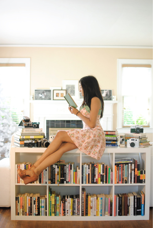 Sometimes I photograph myself reading a book in a dress that I made and sewed. I hope you enjoy this photo. :)