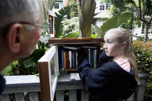 notational:  oeste:  latimes:  Little Free Library brings neighbors together through books: A nationwide movement, Little Free Library prompts bibliophiles to put up small shelved structures outside their homes where people can take books and leave some too. The result can be conversation, friendship and a sense of community.  In the half a year that Beggs' Little Free Library has perched on a post in front of his Sherman Oaks home, it has evolved into much more than a book exchange. … When a 9-year-old boy knocked on his door one morning to say how much he liked the little library, Beggs knew he was on to something.   Photo: Fiona Sassoon, 10, gets some neighborly advice from David Dworski, left, on book selections at Dworski's diminutive outdoor library in Venice. Credit: Michael Robinson Chavez / Los Angeles Times  Definitely doing this when I have my own place some day.  I've seen at least one of these in the new neighborhood that I'm moving to in Walla Walla.