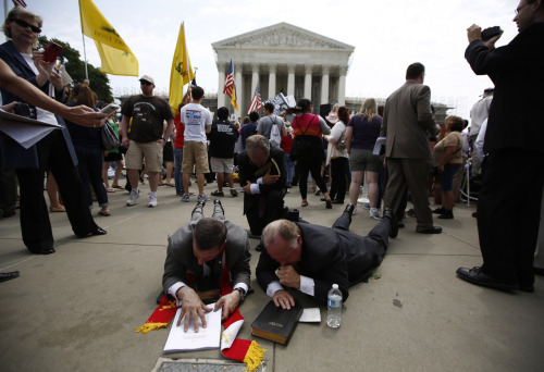 reuters:  Religious leaders lay on the ground and pray over a bible and a copy of the verdict on President Barack Obama's signature healthcare overhaul law outside the Supreme Court in Washington June 28, 2012.  The U.S. Supreme Court upheld President Barack Obama's healthcare law on Thursday in an election-year triumph for him and fellow Democrats and a stinging setback for Republican opponents of the most sweeping overhaul of the unwieldy U.S. healthcare system in about a half century. [REUTERS/Jason Reed] PHOTOS: Supreme Court rules on Affordable Care Act