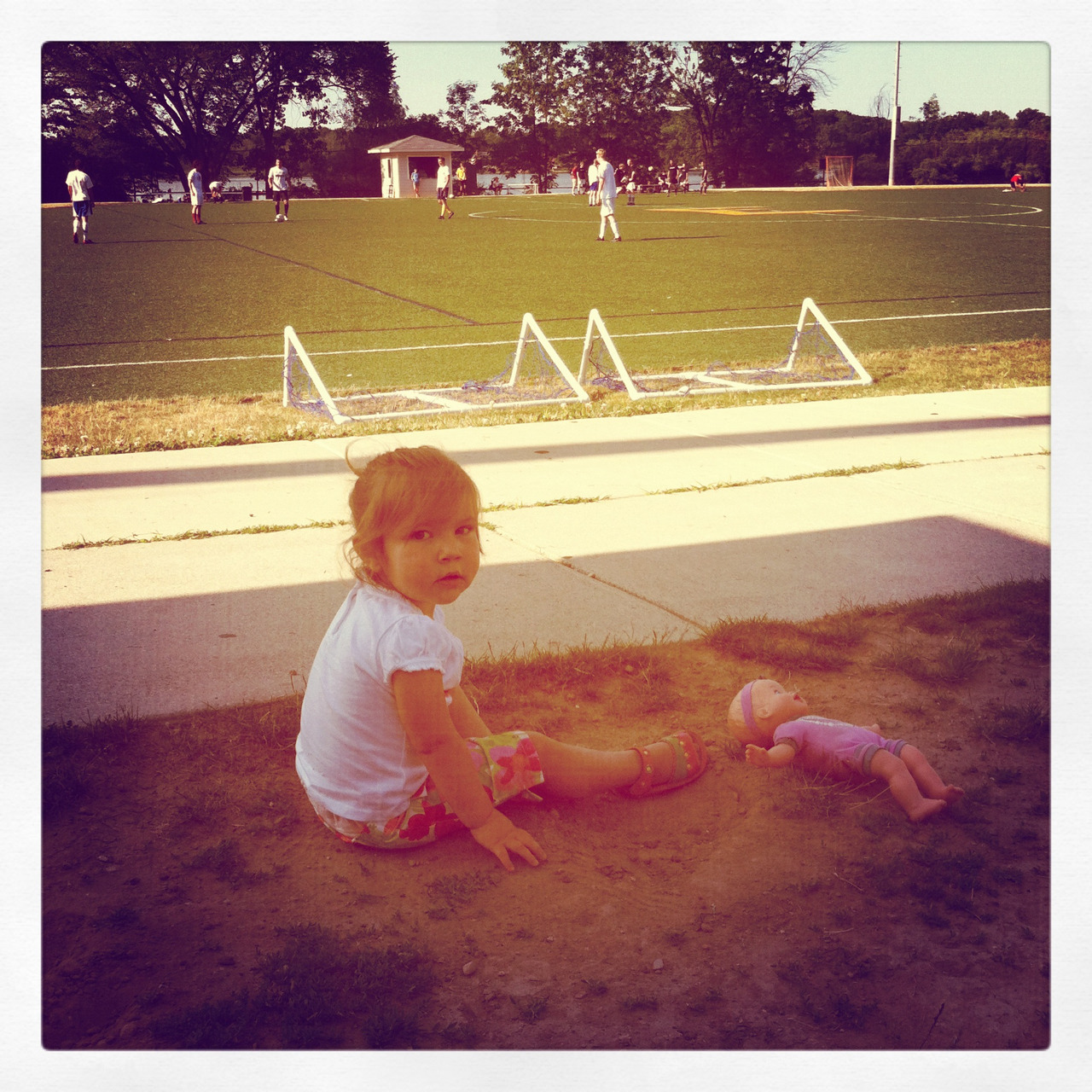 June 26, 2012 Addison watching daddy and uncle Steve play soccer