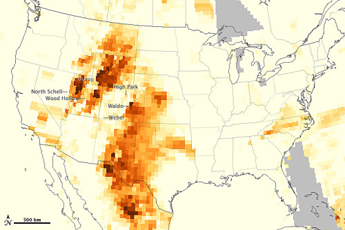 "Extreme weather: ""Epic dryness' feeding Western wildfires' From USA Today:  In the Rocky Mountain West, firefighters say they've never seen the trees and grasses this dry so early in the summer. ""It's epic dryness,"" says Beth Lund, leader of the incident management team assigned to the High Park Fire, which has burned 135 square miles near Fort Collins, Colo., and destroyed at least 257 homes. It is now the most destructive in recorded Colorado history. But hardly the only one. Ten separate fires are burning in Colorado, prompting a planned visit Friday by President Obama. They threaten the U.S. Air Force Academy, the town of Boulder and the city of Colorado Springs. Colorado isn't the only state affected by an exceptionally severe fire season, with crews battling blazes in Alaska, Arizona, California, Montana, Nevada, New Mexico, Utah and Wyoming. ""The whole Central Rocky Mountain range is a tinderbox,"" says Ron Roth, of the Rocky Mountain Area Coordinating Center in Lakewood, Colo. A light winter snow pack, dry spring, more people living in what was once wilderness and the long-term effects of climate change have all conspired to make this an especially bad fire season, Roth says. ""We've got trees torching, tornadoes of fire — this is extreme fire behavior,"" he says. … Climate change is undoubtedly playing a role, if only in the distribution of invasive insects, Delgado says. The pine bark beetle has been migrating north for years as warmer winters allow it to survive outside its previous range. The insects have killed millions of acres of forest, leaving behind tinder-dry wood. ""When that timber goes dead, it doesn't make for a real good situation when the fire comes,"" Bently says.  Check out the rest of the article here. Related: 'West's wildfires a preview of changed climate: scientists' (Reuters) 'Climate change will boost number of West's wildfires' (Reuters) (Map credit: NASA via Yale e360)"