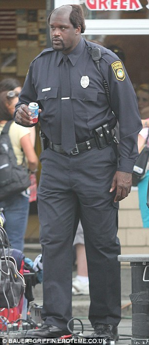 tallwhitney:  Shaq on the set of Grown Ups 2  Is that a regular-sized soda can in his hand!?