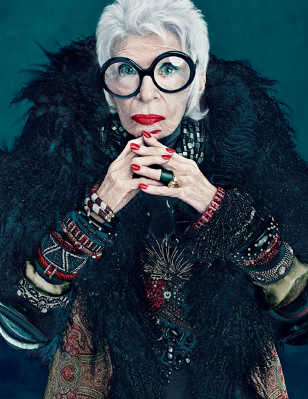 "Fashion Icon Friday: Iris Apfel  Iris Apfel is by far the most stylish 90 year old lady we can think of. A native New Yorker, she studied Art History at NYU. When she was younger, Iris worked for Women's Wear Daily and also for an interior designer. After marrying her husband, Carl Apfel, they founded the textile firm, Old World Weavers (from which the two retired in 1992). They even worked on designs for the White House for nine different presidents. Iris is a fashion icon known for her round oversized glasses. The line eyebobs even collaborated with her to create a limited edition frame named ""Iris,"" inspired by her style—which is bold and bright, much like her personality. In 2005, the MET featured an exhibit all about Iris titled, Rara Avis (Rare Bird): The Irreverent Iris Apfel. Recently, MAC cosmetics collaborated with Iris creating a line that emulates her style with bright lipsticks and colorful eyeshadows. Watch this interview with Iris made by the Peabody Essex Museum during the traveling exhibit of Rara Avis (Rare Bird): The Irreverent Iris Apfel. We hope we're still this awesome at 90!"