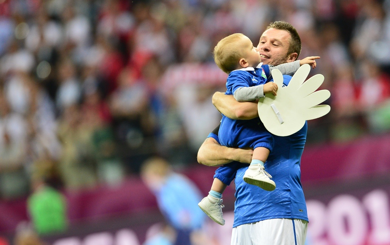 Italy wins! Here is a photo of a Italian player Antonio Cassano celebrating with a baby. You're welcome. Better luck next time, Germany.