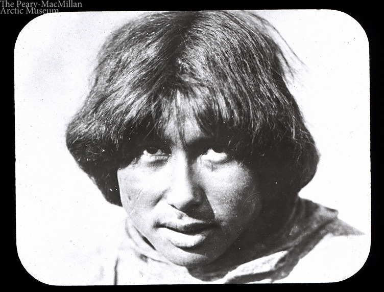 Headshot of an unknown Inuit man. Taken by Donald MacMillan on the Crocker Land expedition, 1913 - 1917.