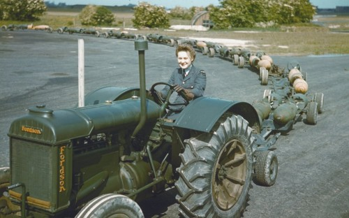 womenatwar:  A WAAF tractor driver with a train of full bomb trolleys, RAF Mildenhall 1942  coming to your town…to blow shit up…