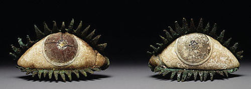 Pair of Eyes Classical Greek (c.5th century BC) Eyes like these were inlays for bronze statues to make them more life like. Bronze statues originally shone pale brown (almost like flesh), lips and nipples were often made from copper, and teeth in silver. This pair of eyes were made for an over life-size figure and is made from bronze, marble, frit, quartz and obsidion.   Source:The Metropolitan Museum of Art