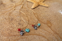 Red coral. bumble bee shell. white sea glass. turquoise.