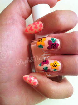 "simple heart polka dots and flowers. got acrylic done on top of my natural nails to keep them heard and to prevent them from breaking. but yes! this is my natural nail length ;) ""A Crewed Interest"" by Essie as the base"