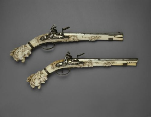 peashooter85:  17th Century Flintlock Pistols These pistols were made in Maastrict, Netherlands in 1655.  These pistols, and many other similar pistols, were used as gifts by the Dutch East India Company and other trading companies to help negotiate contracts and business.  Amazingly, these pistols are each made from a single piece of ivory.  The set was originally owned by H. L. Vissner, an antique and military firearms collector who specialized in 17th and 18th century weapons.  His collection included 943 pieces Today these wonderful pistols are on display at the Rijksmuseum in Amsterdam.
