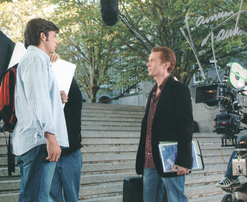A behind the scenes picture from Aqua featuring Tom Welling and James Marsters.  Signed by James Marsters. James Marsters' response to seeing this picture:I remember this day. They had to figure out where to place the apple boxes for me to stand on so I wouldn't look so short next to Tom Welling. He's a tall guy.