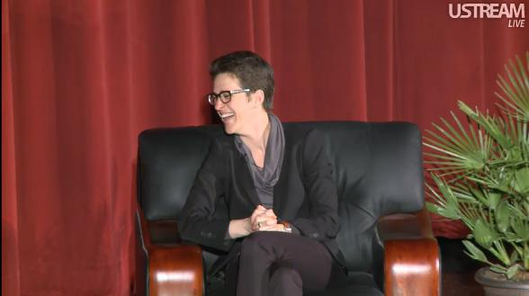 """Maddow's brand is not so much out lesbian or angry liberal, but full-on nerd: the chunky black glasses, the flailing limbs."" Rolling Stone, Rachel Maddow's Quiet War. Photo screencap via solangel"