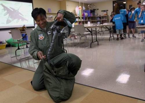 notesfromthegarden:   Air Force Major Shawna Rochelle Kimbrell, the first black female fighter pilot and a mother of two, stopped by the Children's Museum of Indianapolis to talk with dozens of children ranging in age from 6 to 12 in the museum's neighborhood summer enrichment program. Kimbrell, 36, whose family moved from Lafayette to Colorado shortly after she was born, was expected to meet and greet more than 400 visitors during her visit, including families of the Tuskegee Airmen. The Indianapolis Star sat down with Kimbrell after she met with a class of kids: ….  Q: What message do your achievements send to African-American women, or women in general? A: Hopefully the message is that there's no barrier too high. That there's nothing they can't do. One is to set goals for yourself. It's kind of like the road map through life and there's no way you're going to get somewhere if you don't know where you're going. And two is to believe in yourself, because you're the only one that knows what you can do. And finally, never quit.  Fly!