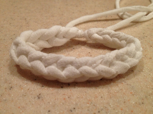 100 Ways to Transform a T-shirt: 14 This knit bracelet is so cute, and it can be made from t-shirt yarn! I followed a great tutorial from the blog V and Co, which you can access by clicking through the picture of the one I made myself. It calls for jersey knit material, but I recommend you substitute with unstretched t-shirt yarn (t-shirts are jersey knit!).