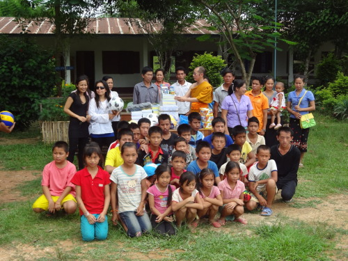 School supplies and sports equipment being donated to a school near Nong Khiaw, Laos