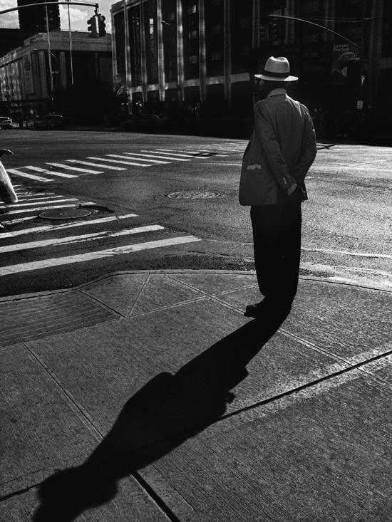 Man standing on sidewalk , Manhattan 2012