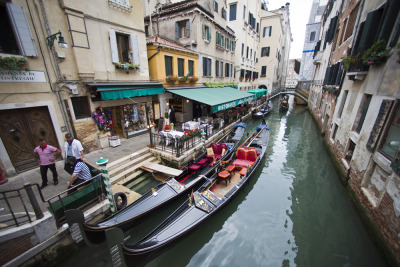 Digital Diary: 7 Artists. 7 Days. 7 Videos. Photo 88 of 90. Gondolas in Venice wait for customers. Although the digital diary was filmed all in Friuli Venezia Giulia, after the filming I had a couple spare days to spend in Venice. So my photo diary extended a bit. It was my first time visiting the ancient city and my impression of the place was truly fantastic. I've been traveling for many years now, but this place was simply stunning. From the canals to the architecture, it is truly a unique place in the world. Second in the Digital Diary of Italy series, a set of seven young video makers from all over the world joined us in Friuli Venezia Giulia to do some serious storytelling. I was one of those seven. Over the seven day assignment in Italy, we were force fed prosciutto and drowned in wine daily as we went from the Italian Alps to the Mediterranean Shores. We went kite surfing, horse back riding, caving and cruised through vineyards on vespas (or in my case, a sidecar). I would wake up on a small island and go to bed in an ancient castle. This photo series documents my digital diary of Friuli Venezia-Giulia. The photos accompany this video.  The area is truly beautiful with an amazing population. Please help share the place with your networks by sharing this video. Mille Grazie! Jonah
