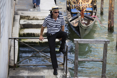 Digital Diary: 7 Artists. 7 Days. 7 Videos. Photo 89 of 90. A gondola driver waits for customers in Venice. Although the digital diary was filmed all in Friuli Venezia Giulia, after the filming I had a couple spare days to spend in Venice. So my photo diary extended a bit. It was my first time visiting the ancient city and my impression of the place was truly fantastic. I've been traveling for many years now, but this place was simply stunning. From the canals to the architecture, it is truly a unique place in the world. Second in the Digital Diary of Italy series, a set of seven young video makers from all over the world joined us in Friuli Venezia Giulia to do some serious storytelling. I was one of those seven. Over the seven day assignment in Italy, we were force fed prosciutto and drowned in wine daily as we went from the Italian Alps to the Mediterranean Shores. We went kite surfing, horse back riding, caving and cruised through vineyards on vespas (or in my case, a sidecar). I would wake up on a small island and go to bed in an ancient castle. This photo series documents my digital diary of Friuli Venezia-Giulia. The photos accompany this video.  The area is truly beautiful with an amazing population. Please help share the place with your networks by sharing this video. Mille Grazie! Jonah