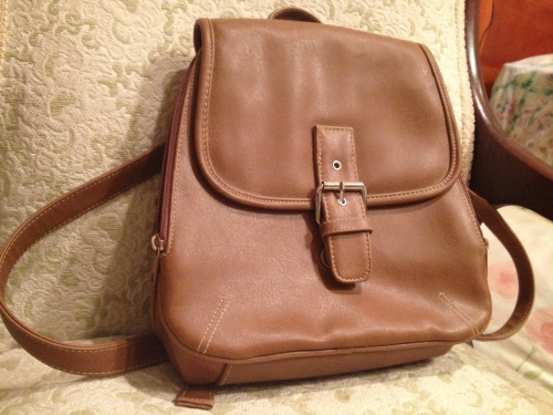 I got this great (although I'm sure faux) leather backpack today at the thrift store. It's in great condition, the silica gel pack was still in place and everything. It cost me a whopping 2.48, which is quite the splurge for me. What can I say, I'm in love c;