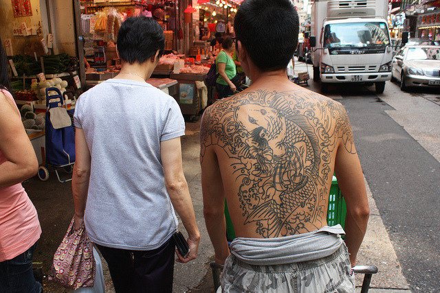 along for the ride on Flickr.Via Flickr: Guy with a large back tattoo, Wan Chai wetmarket, Hong Kong.