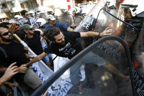 Cypriots living in Greece clash with the police during a protest against the visit of leader of Turkey's Nationalist Movement party (MHP) Devlet Bahceli in Thessaloniki June 28, 2012. MHP's leader Bahceli visited the Turkish consulate which is the birthplace of Kemal Ataturk, the founder of modern Turkey.