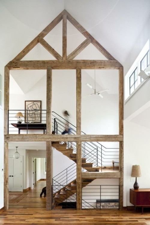 "sweet-designs:  The skeleton of the house is outlined inside in reclaimed wood, and a David Weeks Studio ""Torroja Cross"" chandelier floats gracefully above the stairwell."