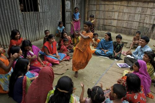 unicef:  A girl dances to a folk song in the centre of group of adolescents, all of whom are girls, in the municipality of Driver Para, in Gaibandha District of Bangladesh. The adolescents are part of a community group that is discussing plans to speak to local residents about hygiene practices. Adolescent community groups are organized by UNICEF, the international NGO CARE and the Government to raise awareness about community and environmental sanitation. © UNICEF/Shehzad Noorani http://www.unicef.org
