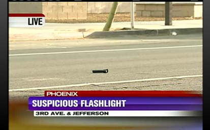 Suspicious Flashlight I mean, what's it doing? Not illuminating dark objects like it's supposed to, that's for sure. And why isn't someone holding it? No, nothing about this makes sense.