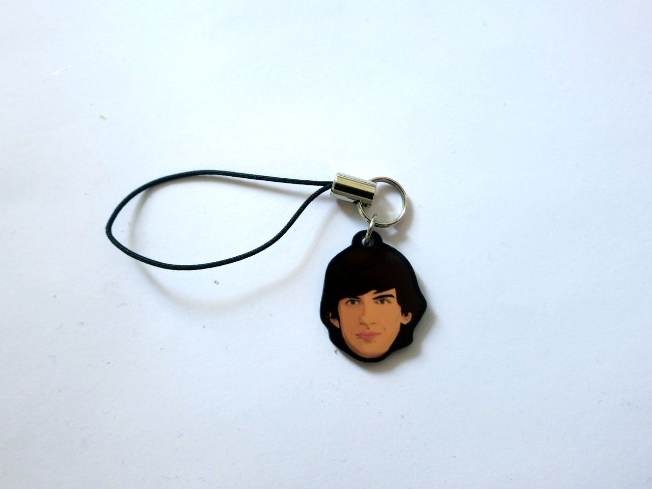 valentineuhovski:  A David cell phone strap. This was part of the AMAZING gift box kind folks from Pusheen sent to our wondrous Tommy.