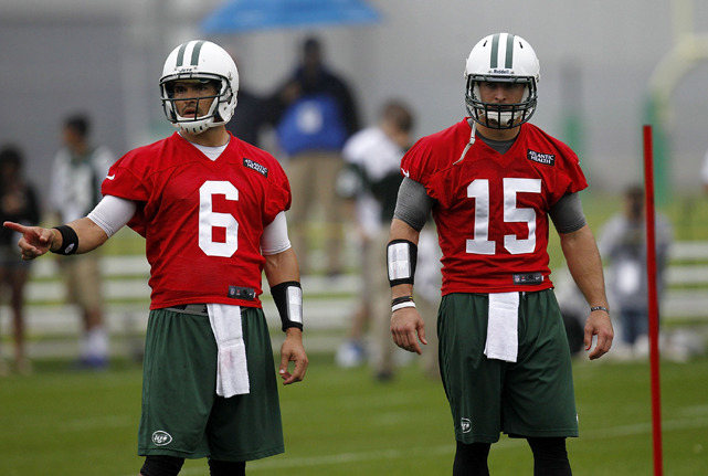 Jets quarterbacks Mark Sanchez (No. 6) and Tim Tebow (No. 15) work out at an organized team activity in Florham Park, New Jersey last month. The relationship between the two quarterbacks is one of the biggest stories of the 2012 NFL season. (Photo by Jeff Zelevansky/Getty Images) MANTZOURANIS: New York Jets 2012 Offseason Breakdown