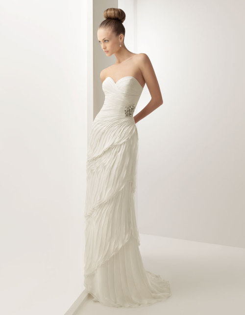 "The rouching on this silk chiffon gown looks like a graceful cascade of feathers. Soft by Rosa Clara 2012, style no. 109 ""Helena"". Read full post here."