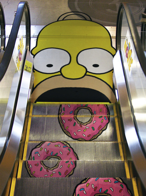 For you Simpson fans out there, heres a cool guerrilla marketing technique using Homer Simpson. This was used to promote the Simpsons movie a while back. This definitely grabs attention of thousands who walk on this each day and there's no way these people don't tell their friends (word of mouth). Probably some expensive ad space right there.