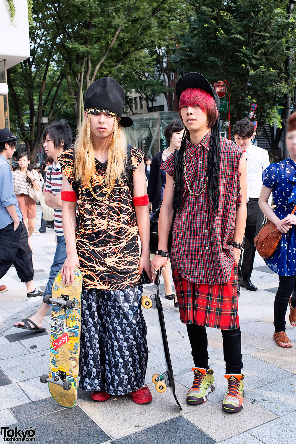Harajuku skaters - one wearing SPX sneakers, the other in Jeremy Scott x Adidas.