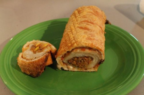 Beer-Battered Deep Fried Pizza Wrapped around a Burrito  What? No ranch dressing?