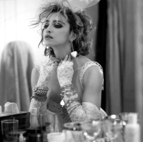 "Madonna, ""Like a Virgin"" photo shoot, 1984 by Steven Meisel Lace, lingerie, big hair, defined eyebrows, and accessories galore…Madonna's influence on fashion during the 1980s is undeniable. Her unforgettable ensemble from the 1984 album ""Like a Virgin"" changed the fashion scene and created a whole new style. The iconic cover photo made Madonna the epitome of cool and a true style icon."