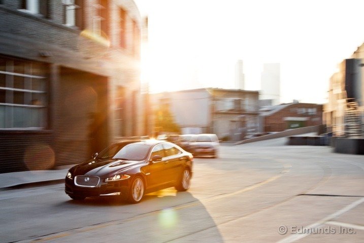 2012 Jaguar XF Supercharged Long-Term Test  Nobody notices our new long-term 2012 Jaguar XF as it slides through traffic. So we put it in Dynamic mode, double-tap the downshift paddle and make the exhaust crack and pop like a hunk of hot iron dipped into a bucket of water. Still, nobody notices, or at least they don't think it's our black Jaguar sedan. We rev the 5.0-liter supercharged V8 at a stoplight to hear the growl ricochet off the retaining walls and though the car visibly shakes like an old hot rod each time the V8 settles back into its engine mounts, nobody suspects the sedate British four-door. Read more