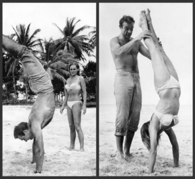 sean connery and ursula andress doing handstands on set of dr. no