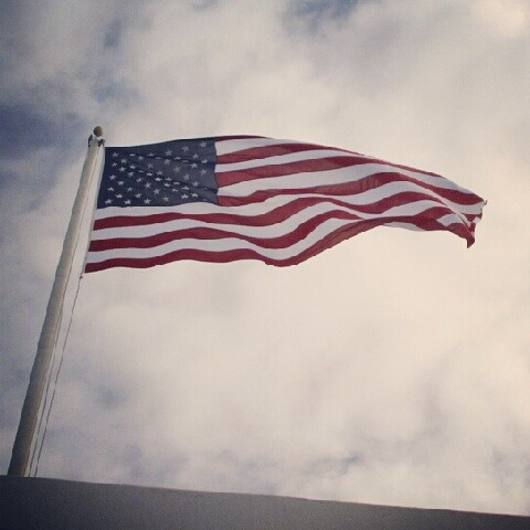 The flag flying over the memorial of the USS Arizona in Pearl Harbor in Hawaii.