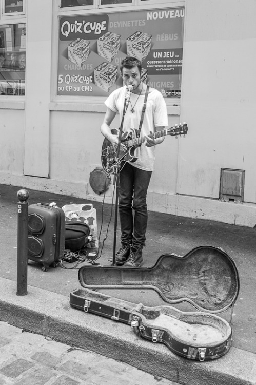 Walking through the Latin Quarter in Paris, there was this guy singing with such energy! Really moving!