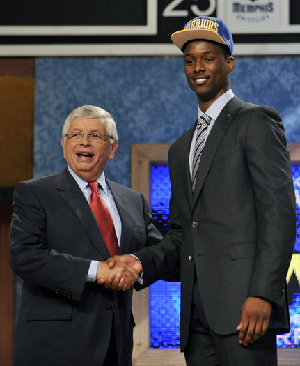 NBA Commissioner David Stern, left, poses with the No. 7 overall draft pick Harrison Barnes, of North Carolina, who was selected by the Golden State Warriors in the NBA basketball draft